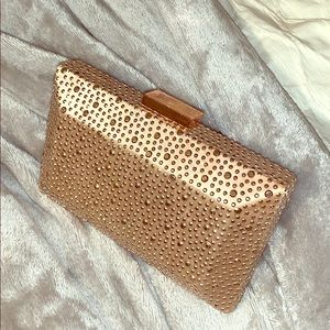 Rose gold studded clutch, with removable chain